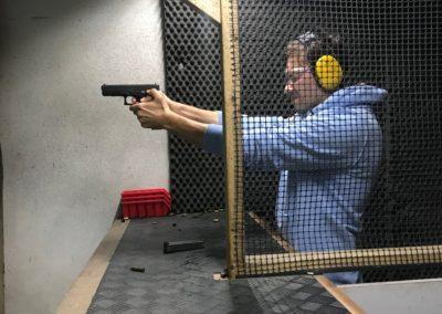 a guy shooting-min