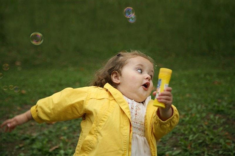 Girl in yellow raincoat running away
