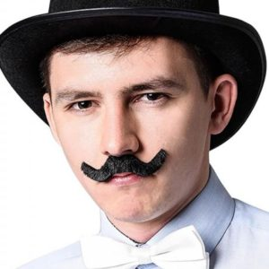 guy in a funny stag do outfit with hat and moustache