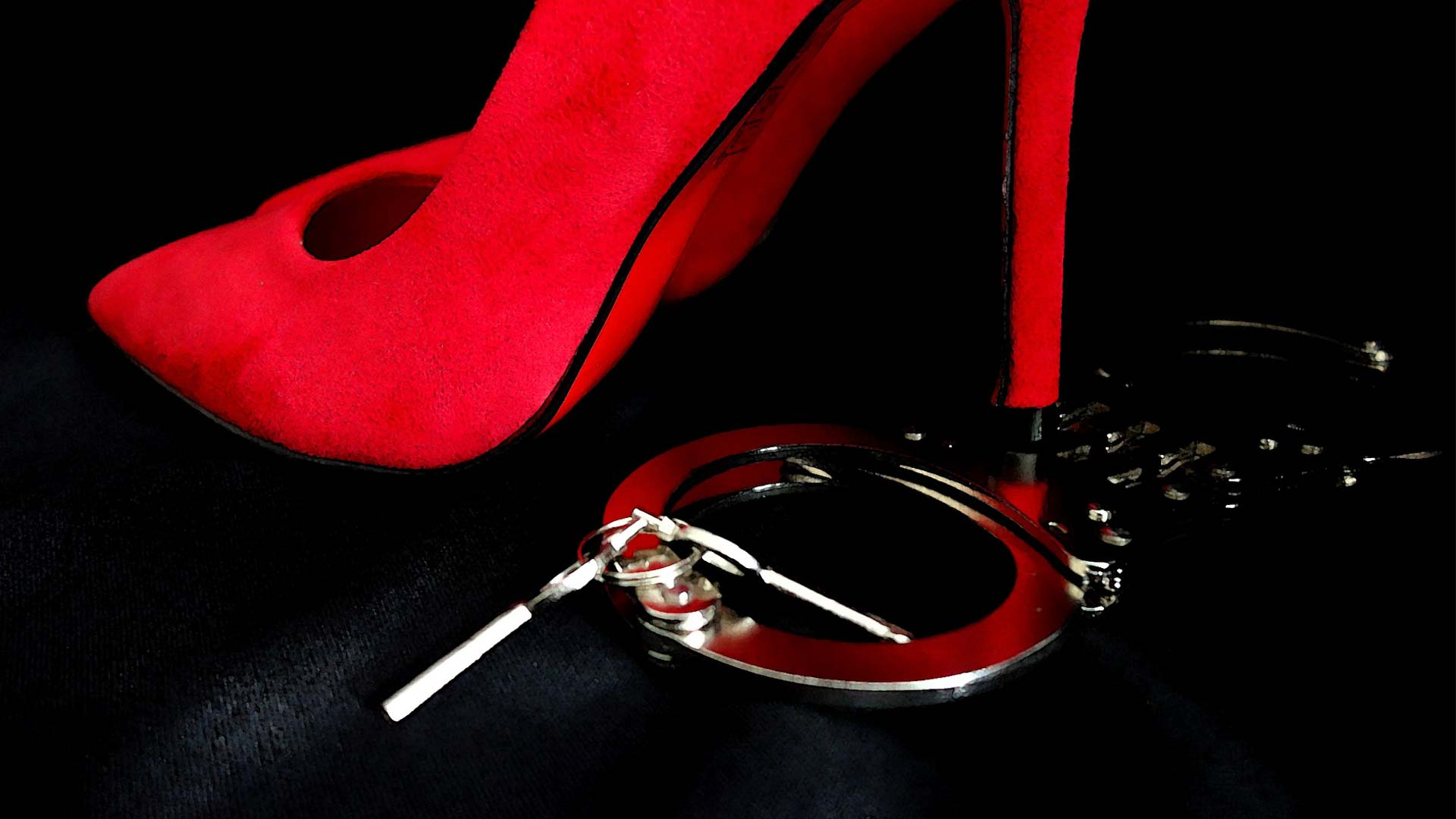 Red high heels and handcuffs